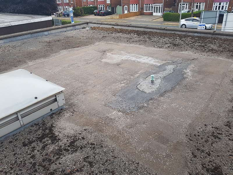 Existing damaged flat roof in need of repair
