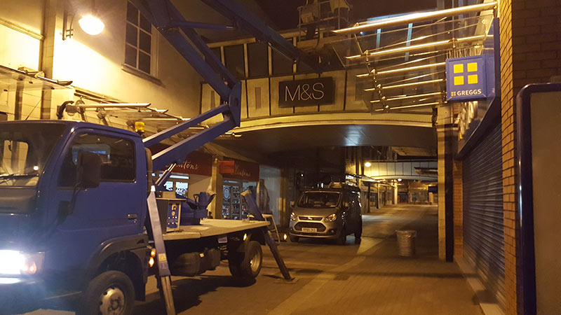 Cherry picker parked in street completing high level work