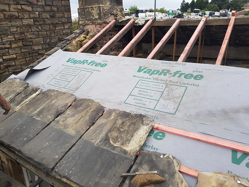 re roof installation using stone tiles