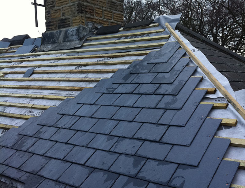 New slate tile roof being installed